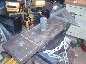 Photo: The post gets welded on like this. I am just checking square and double checking. I only really get one chance to weld it down.