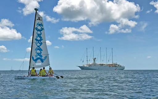 sandals-pigeon-island.jpg - A Sandals sailboat takes in Windstar's Wind Surf on Pigeon Island, St. Lucia.