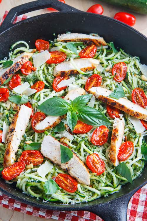 """Pesto Zucchini Noodles with Roasted Tomatoes and Grilled Chicken""""A light and tasty..."""