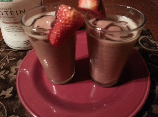 Pour into 2 8 oz glasses, garnish with strawberries and Hershey's syrup! Serve up!