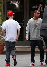 """Photo: 78563, LOS ANGELES, CALIFORNIA - Friday May 25, 2012. Newly graduated Justin Bieber spotted wearing a """"Doing Real Stuff Sucks"""" t-shirt while leaving a recording studio in Burbank. The 18 year old, who recently bought a multi-million dollar house, recently received his GED, and got a surprise high school mock graduation ceremony on Ellen Degeneres' chat show. He is seen wearing a red Detroit Red Wings hockey cap along with red Converse sneakers. Photograph: Bruja, © PacificCoastNews.com **FEE MUST BE AGREED PRIOR TO USAGE** **E-TABLET/IPAD & MOBILE PHONE APP PUBLISHING REQUIRES ADDITIONAL FEES** LOS ANGELES OFFICE:+1 310 822 0419 LONDON OFFICE:+44 20 8090 4079"""