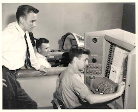 Photo: May 1958 TD2 Cliff Bosworth familiarizes himself with the control panel of the F9F-8T cockpit simulator in the Ground Graining Dept.
