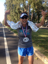 Photo: Jeaney crossing the finish line, in memory of Boston, a week later at Honolulu Marathon finish line, Kapiolani Park.