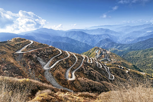 Peak power: Roads curve beautifully along a stretch of what used to be the Silk Road in the mountains between China and Sikkim in India. Picture: 123RF