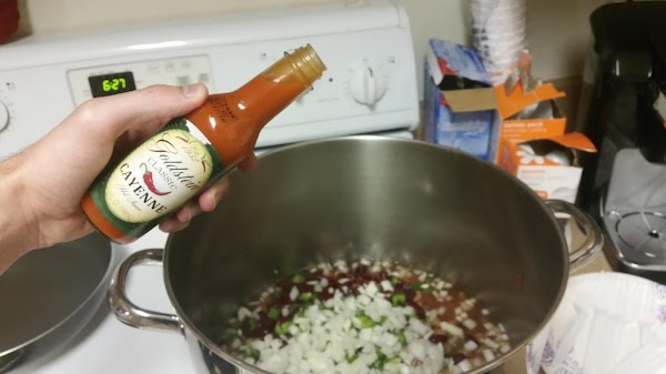 Toss the peppers, onion and the contents of all the cans into the pot....