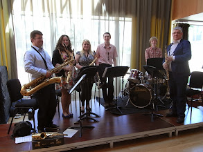 Photo: The University Sax Ensemble, led by Peter Cook (left), on the foyer-stage at Jazz Day.