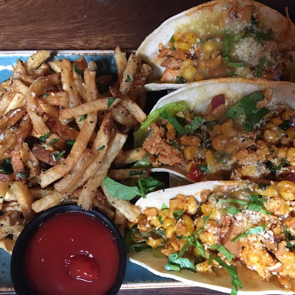 Street tacos (chicken tinga) and truffle fries.   Tinga spice is spicy, but excellent.