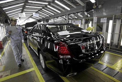 Production roll-out: An employee checks new cars at a Toyota car plant in Tianjin in northeastern China. Picture: REUTERS