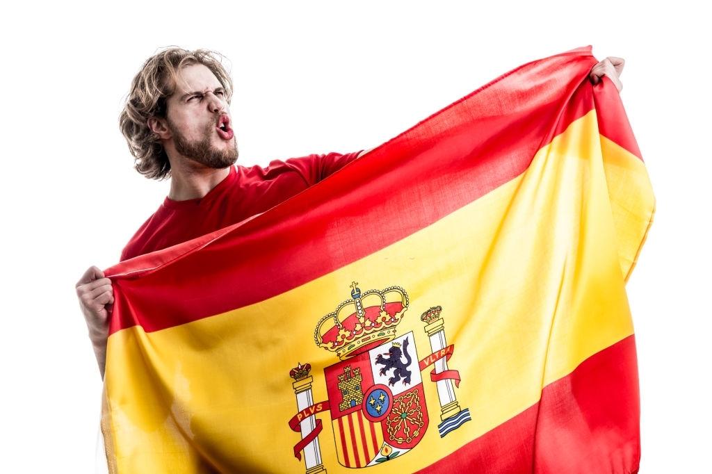 Spaniard with a Spanish flag.