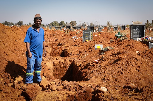 Zola Nqunqa, 59, has been working as a grave digger since 1991.