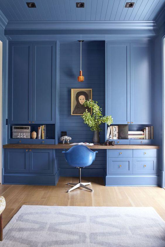 built in cabinets wooden desk blue shiplap orange pendant modern chair inspirational home office
