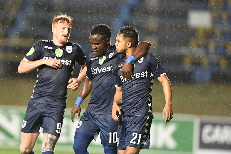Bidvest Wits winger Haashim Domingo (R) celebrates scoring his goal with teammates Simon Murray (L) and Gabadinho Mhango (C) during the Nedbank Cup last 32 match against Limpopo ABC Motsepe League side Boyne Tigers FC at Bidvest Stadium on January 23, 2019.