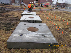 Photo: Dead weights for axial loading of combined axial and lateral test shaft.
