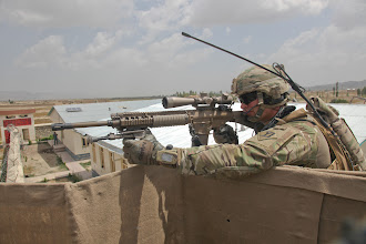 Photo: U.S. Army Sgt. Robert Marks with the 2-113th Infantry Battalion, New Jersey National Guard, aims a 110 sniper rifle atop an observation post outside the village of Sarobi in Paktika province, Afghanistan, July 11, 2011. The purpose of the mission was to provide security for the Paktika Provincial Reconstruction Team, who supports stability operations in the village.