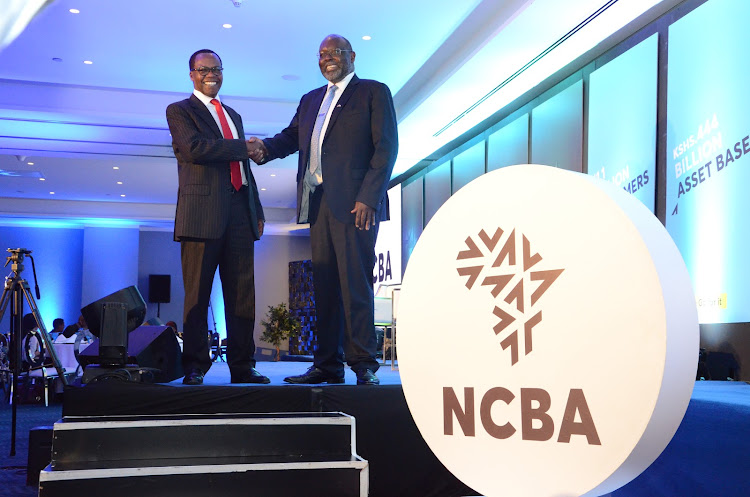 NCBA Bank Kenya PLC designate chairman Isaac Awuondo with group managing director John Gachora during the unveiling of NCBA group new logo at Raddison Blu Hotel,Nairobi,October 3rd 2019,/DOUGLAS OKIDDY