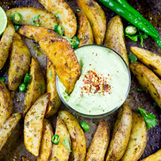 Perfect Baked Potato Wedges with Avocado Crema.