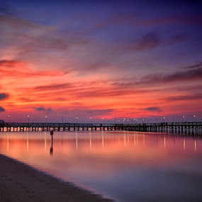 The Beauty of a New Day by James Gramm - Landscapes Waterscapes ( clouds, water, sand, sky, colors, reflections, pier, long exposure, beach, sunrise, river )