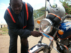 Photo: A local pikipiki rider using Eco-Pesa. Displaying a sticker so people know they can use Eco-Pesa with him.