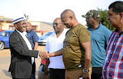 North West MEC for  sports Sello Lehari, left,  during a visit to Chippa Masinga's home in Khuma.  /  Tiro Ramatlhatse