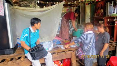 Photo: Huai Jajan: Lahu family home care with Pon (Lahu translator) and Chalao and Kanda
