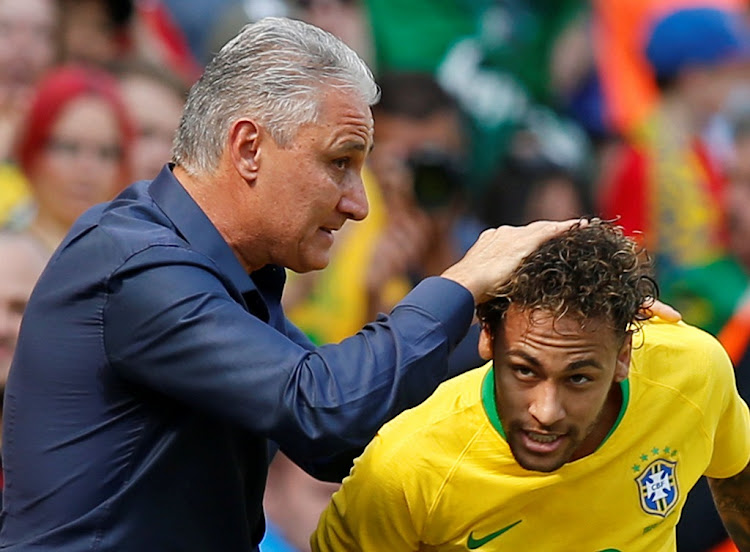Brazil's Neymar celebrates scoring their first goal, against Croatia, with coach Tite, June 3 2018. Picture: REUTERS/ ANDREWS YATES