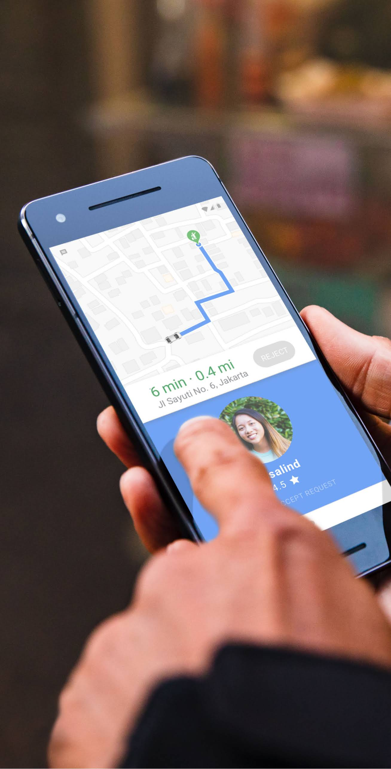 Phone showing on-demand ride on a map with arrival time and location