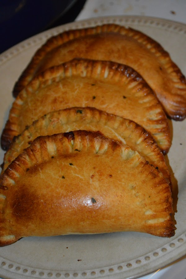 BAKING EMPANADAS: Preheat oven to 400*  Lightly brush the top of the empanadas with the...