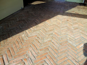 Photo: a nice herringbone brick floor which would have drained well had livestock still been kept here
