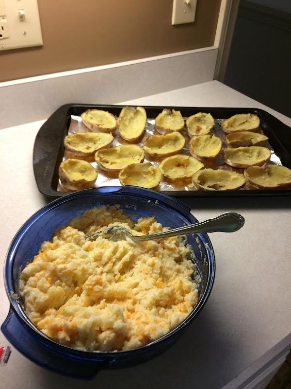 Mix your potatoes, butter, milk, cheese, sour cream, salt & pepper then add back...