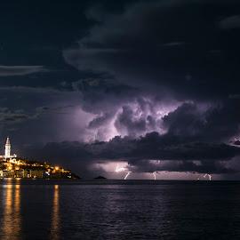 Rovinj and a distant storm by Jernej Lipovec - Landscapes Weather ( sony, lightning, autumn, croatia, sea, weather, citylights, rovinj )