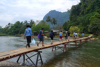 Photo: Starting our Vang Vieng activity day with a river crossing to a collection of caves