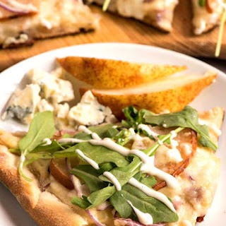 Pear and Gorgonzola Pizza with Arugula and Ranch Dressing.
