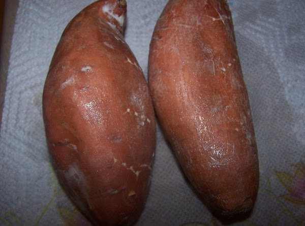 Wash and dry sweet potatoes. Poke holes in potatoes with fork.
