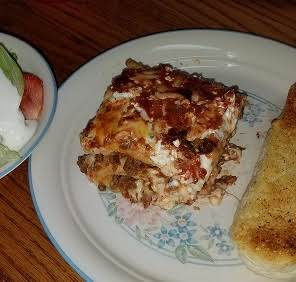Lasagna With A Green Salad And Garlic Bread