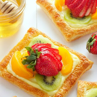 Honey Glazed Fruit Tart with Vanilla Bean Custard Filling.