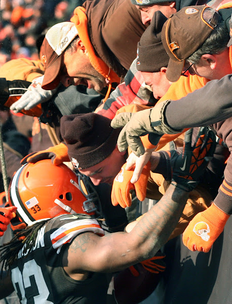 Photo: Trent Richardson celebrates his go-ahead touchdown with the Dawg Pound. (Chuck Crow, The Plain Dealer)