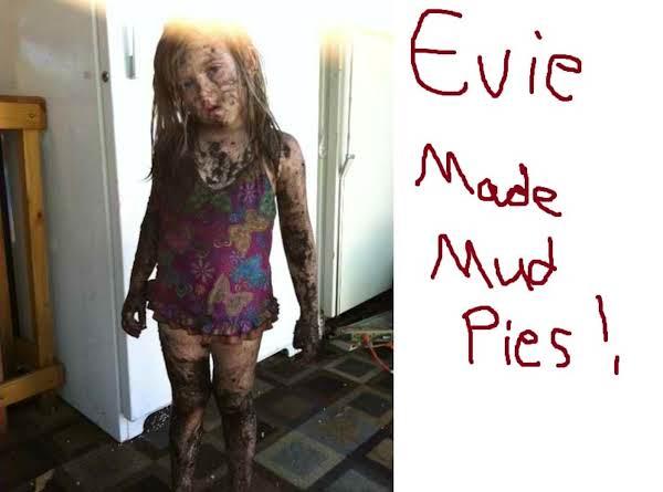 My 6 Year Old Granddaughter Genevieve Evie Was Having Fun Making Mud Pies !
