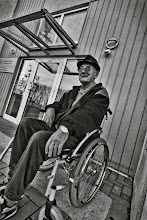 Photo: Amused in a Wheel Chair