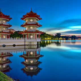 The Twin towers at a garden by Binoy Uthup - City,  Street & Park  Historic Districts ( canon, water, digital blending, chinesegarden, old, refelction, hdr, blue hour, canon5dsr, lake, travel, architecture, landscape, old architecture, singapore, heritage, nightscape, sub urban, garden, culture, river )