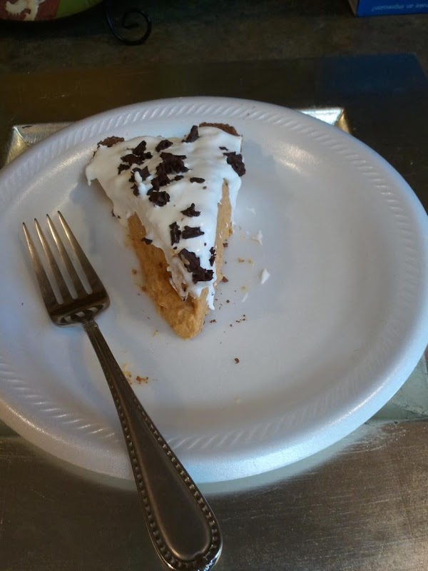 Slice of Easy Pumpkin Pie, that is Diabetic Friendly. Topped with Sugar Free Cool Whip and Chocolate Shavings.