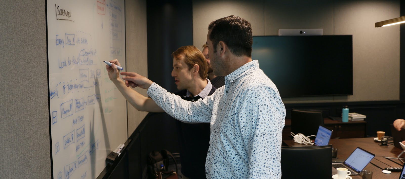 Two engineers reviewing plan for best of 2020 goals.