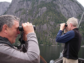 """Photo: """"Hey, there's an eagle!  Where?  Over there!"""" Rick (another engineer) and I scan the area.  Photo by Carolyn."""
