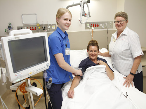 Trainee Assistant in Nursing Trinity Westman, left, checks the blood pressure of her 'patient' Registered Nurse (and also a midwifery student) Renice Baker and Nurse Unit Manager Suellen Stove.