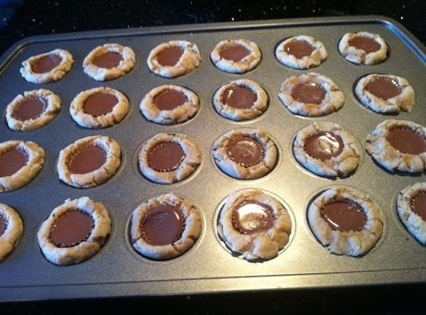 AFTER 8 MINUTES REMOVE PAN N IMMEDIATLEY PLACE ONE MINI PEANUT BUTTER CUP IN...