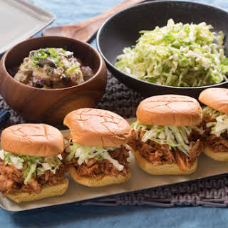 Shredded BBQ Chicken Sandwiches with Creamy Potato Salad & Coleslaw.
