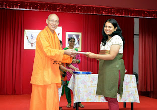 Photo: Mrs Supriya Nayak, volunteer, receiving a token of appreciation from Swamiji