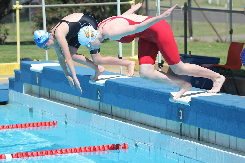 Rachel Caton (in the red) competing at the Narrabri Stingrays LC Qualifying Carnival last Sunday. Rachel finished first in two events - the 13-14-years 100m breaststroke and the 14-years 50m breaststroke.