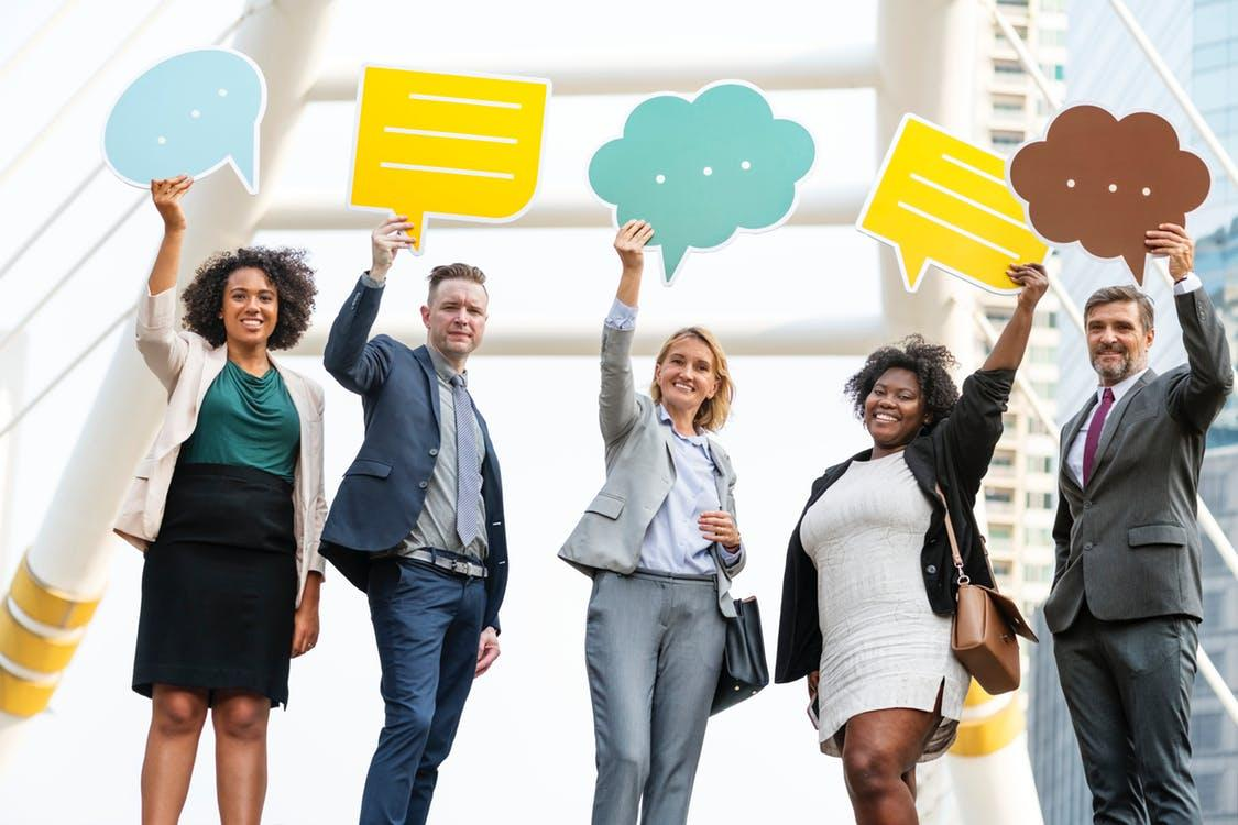 Five Standing People Holding Message Clouds