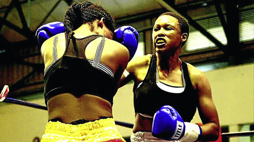 Nozipho Bell, the junior-lightweight titlist, right, in an earlier bout against Nomampondomise Xotyeni.