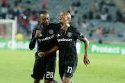 Luvuyo Maemela of Orlando Pirates celebrates his goal with Mthokozisi Dube during the Absa Premiership match between Orlando Pirates and Black Leopards at Orlando Stadium on April 10, 2019 in Johannesburg, South Africa.